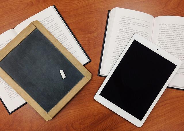 Photo of books, blackboard and ipad.