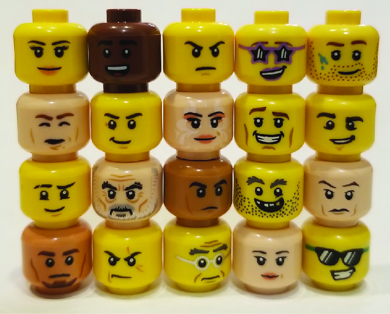 The image shows lego figure heads stacked in five columns, with four heads in each column. The heads show a variety of expressions