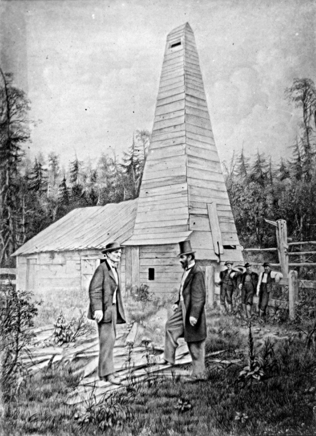 Retouched photograph showing Edwin L. Drake, to the right, and the Drake Well in the background, in Titusville, Pennsylvania, where the first commercial well was drilled in 1859 to find oil