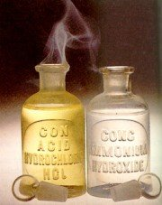 image of two glass bottles with hydrogen chloride and ammonia gas mixing above them.