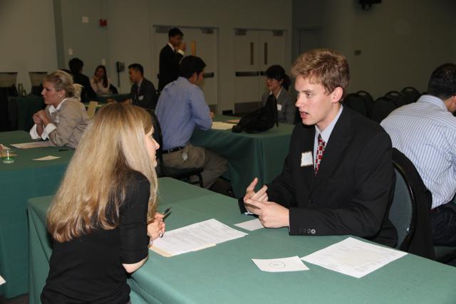 Photo of an interview at a job fair.