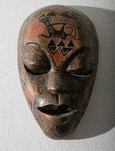 African mask photo by Cezary Piwowarski.