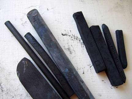 Left: vine charcoal sticks. Right: compressed charcoal squares.
