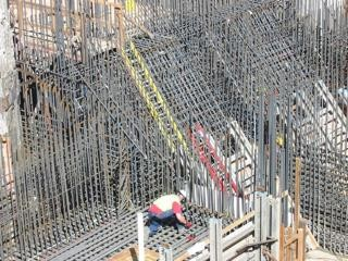 Rebar being set in place for the foundation of a sewage treatment plant pump station