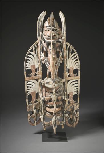 "'Manua Mask', Papua New Guinea. c. 1890. 37"" x 18"" x 10"". Wood, sea sponge, snail apercula, pigment. Los Angeles County Museum of Art"